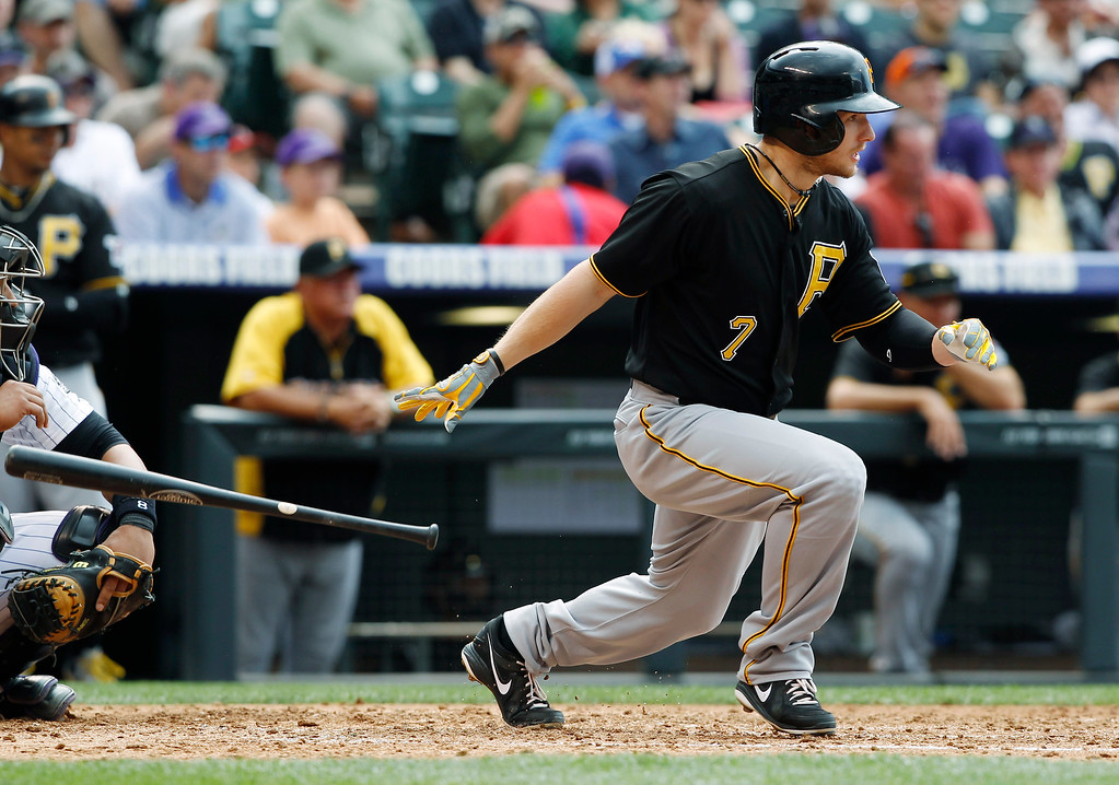. Pittsburgh Pirates\' Alex Presley singles against the Colorado Rockies in the fifth inning a baseball game in Denver on Sunday, Aug. 11, 2013. (AP Photo/David Zalubowski)