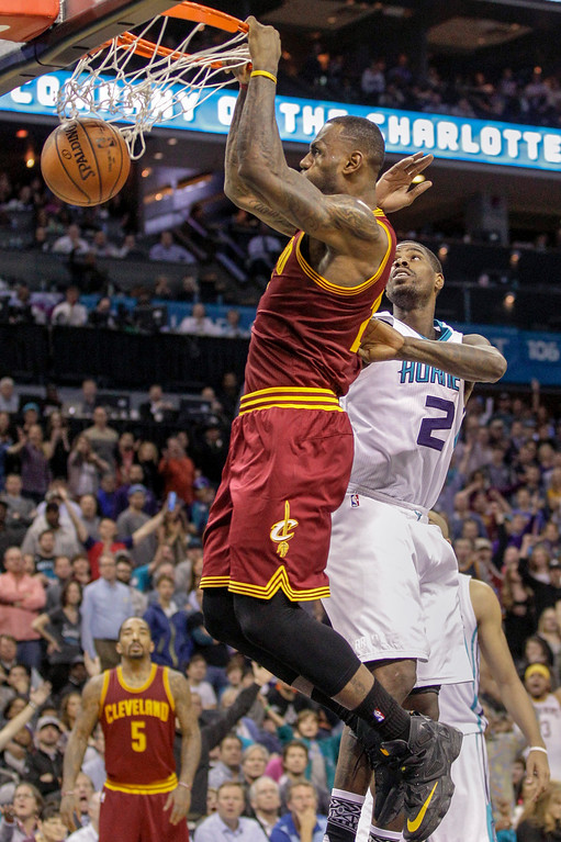 . Cleveland Cavaliers forward LeBron James dunks against Charlotte Hornets forward Marvin Williams during the second half of an NBA basketball game Wednesday, Feb. 3, 2016, in Charlotte, N.C. Charlotte won 106-97. (AP Photo/Nell Redmond)