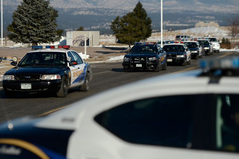 . Police cars arrive for the public memorial service for Tom Clements at the New Life Church in Colorado Springs. March 25, 2013 Colorado Springs, Colorado. (Photo By Joe Amon/The Denver Post)