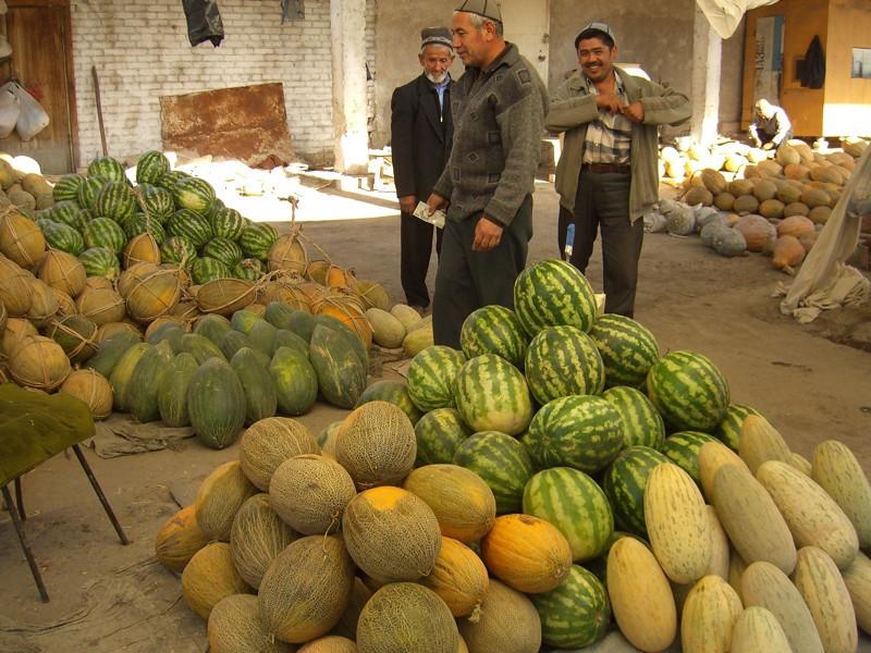 Choosing Melons - Osh Market, Kyrgyzstan