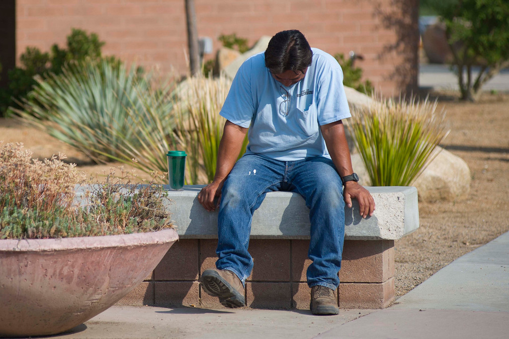. Thomas Herrera   waits for news about whether or not his home survived the Yarnell Hill Fire on Monday, July 1, 2013, at the Red Cross shelter at Yavapai College in Prescott, Ariz.(AP Photo/The Arizona Republic, Aaron Lavinsky)
