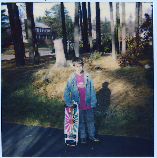 Mike and his lame first skateboard.