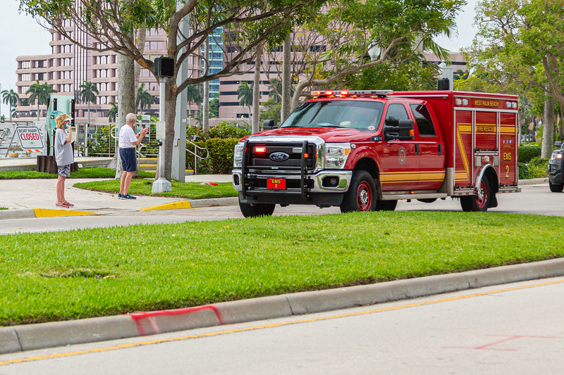 Pedestrians clap and cheer as a procession of emergency vehicles heads north on S. Flagler Drive on their way to honor nurses and doctors at Good Samaritan and St Mary's hospitals in West Palm Beach, Friday, April 24, 2020. [JOSEPH FORZANO/palmbeachpost.com]
