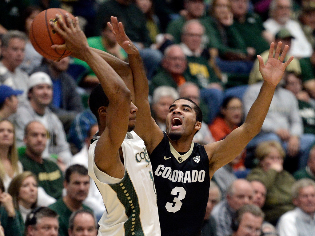 . Colorado\'s Xavier Talton plays defense on Carlton Hurst during an NCAA game against CSU on Tuesday, Dec. 3, 2013, at the Moby Arena in Fort Collins. Jeremy Papasso/ Camera
