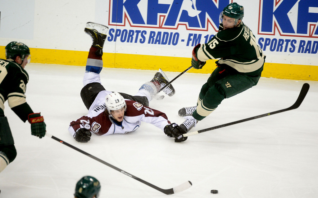 . Colorado\'s Nathan MacKinnon slides on the ice as the Wild\'s Dany Heatley\'s stick is under him during the third period.  (Pioneer Press: Sherri LaRose-Chiglo)