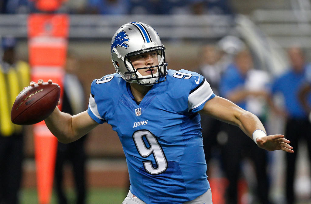 . Detroit Lions quarterback Matthew Stafford (9) throws against the Jacksonville Jaguars in the first half of a preseason NFL football game at Ford Field in Detroit, Friday, Aug. 22, 2014.  (AP Photo/Duane Burleson)