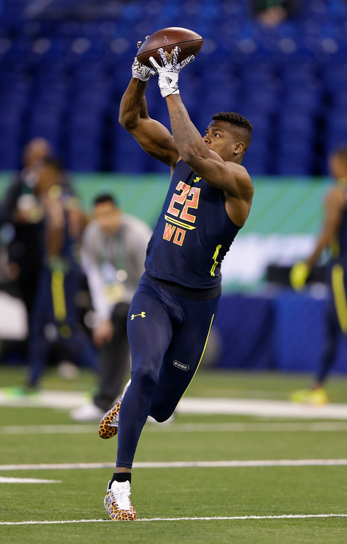 . LSU wide receiver Carlos Henderson runs a drill at the NFL football scouting combine in Indianapolis, Saturday, March 4, 2017. (AP Photo/Michael Conroy)