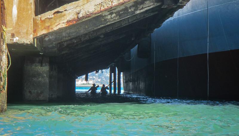 We sneak under the pier.