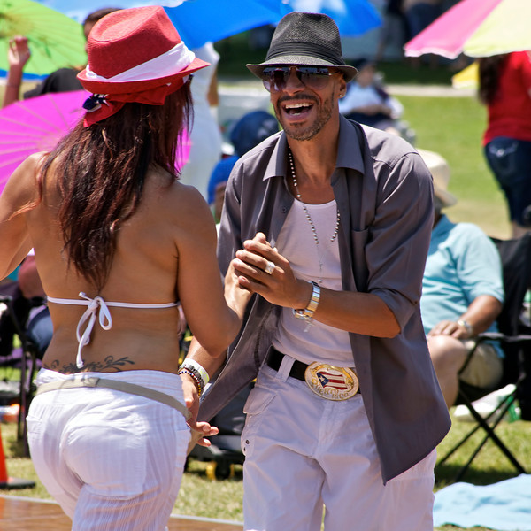 Couple Salsa Dancing at the Puerto Rican festival in Long Beach CA