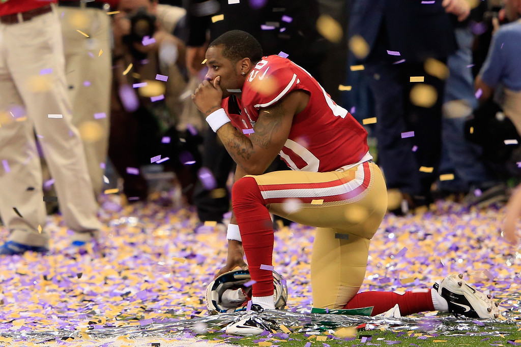 . Perrish Cox #20 of the San Francisco 49ers kneels down among the confetti following their loss to the Baltimore Ravens during Super Bowl XLVII at the Mercedes-Benz Superdome on February 3, 2013 in New Orleans, Louisiana. The Ravens defeated the 49ers 34-31. (Photo by Jamie Squire/Getty Images)