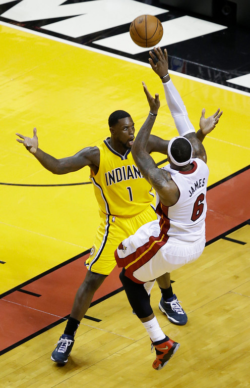 . Indiana Pacers guard Lance Stephenson (1) yells as Miami Heat forward LeBron James (6) attempts a shot to the basket during the second half of Game 6 in the NBA basketball playoffs Eastern Conference finals on Friday, May 30, 2014 in Miami. (AP Photo/Wilfredo Lee)