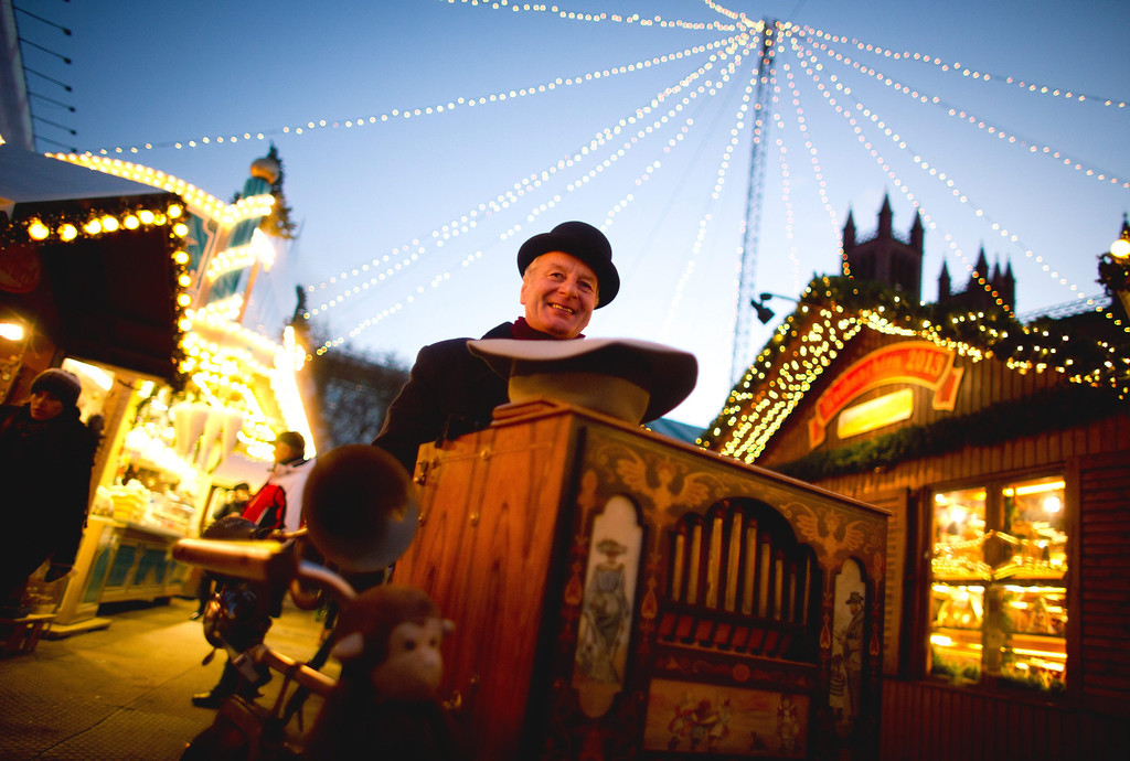 . German Manfred Grabowski plays a barrel organ at the Christmas market at Opernpalais in Berlin, Germany, 25 November 2013. The Christmas market will run until 26 December.  EPA/Kay Nietfeld