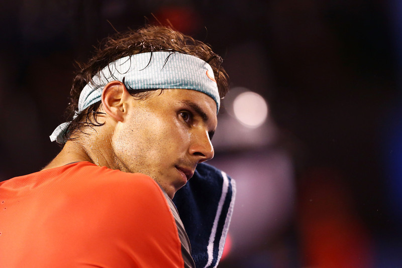 . Rafael Nadal of Spain wipes his face in his semifinal match against Roger Federer of Switzerland during day 12 of the 2014 Australian Open at Melbourne Park on January 24, 2014 in Melbourne, Australia.  (Photo by Matt King/Getty Images)