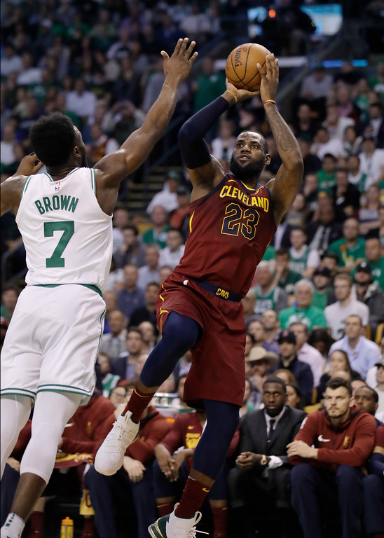 . Cleveland Cavaliers forward LeBron James, right, shoots against Boston Celtics guard Jaylen Brown during the first half in Game 2 of the NBA basketball Eastern Conference finals, Tuesday, May 15, 2018, in Boston. (AP Photo/Charles Krupa)