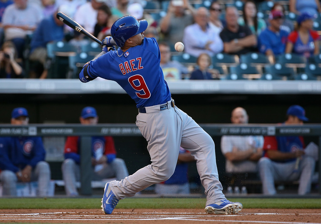 . DENVER, CO - AUGUST 05:  Javier Baez #9 of the Chicago Cubs fouls off a pitch as he strikes out in the first inning at Coors Field on August 5, 2014 in Denver, Colorado.  (Photo by Doug Pensinger/Getty Images)