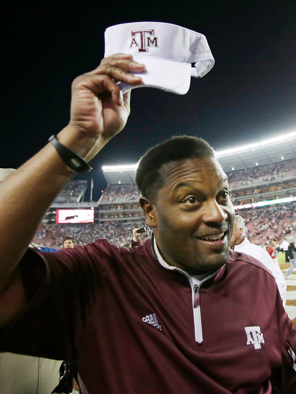 . Texas A&M coach Kevin Sumlin tips his cap following a 29-24 win over top ranked Alabama during an NCAA college football game at Bryant-Denny Stadium in Tuscaloosa, Ala., Saturday, Nov. 10, 2012.  (AP Photo/Dave Martin)