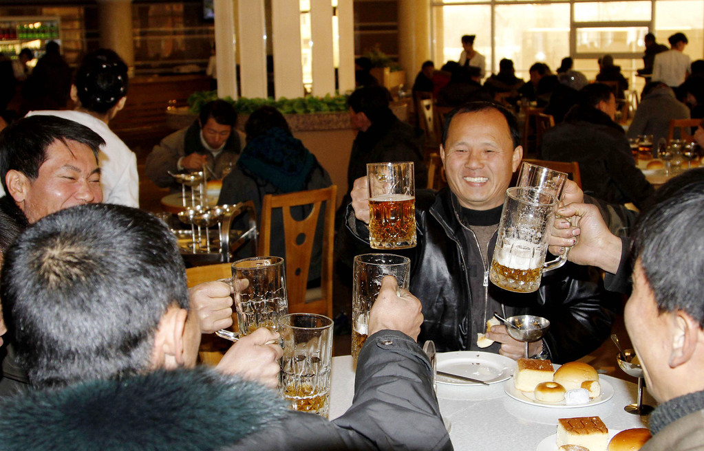 . North Koreans toast after hearing the news of a  rocket launch with beer at the newly-built Mansukyo Restaurant on Wednesday, Dec. 12, 2012 in Pyongyang, North Korea. North Korea appeared to successfully fire a long-range rocket Wednesday, defying international warnings as the regime of Kim Jong Un pushes forward with its quest to develop the technology needed to deliver a nuclear warhead. (AP Photo/Kim Kwang Hyon)
