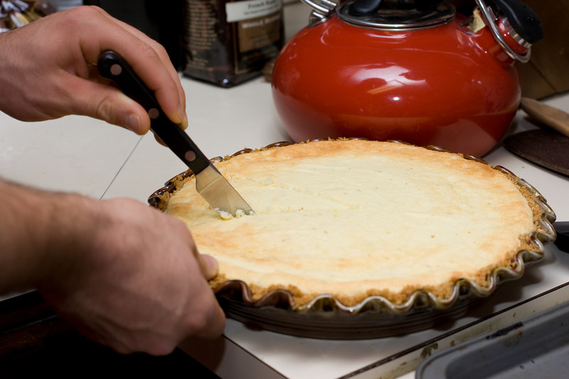 Cutting the cheesecake.