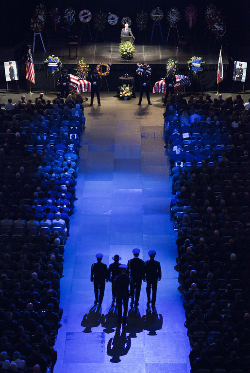 . An honor guard enters during a memorial honoring Santa Cruz Police Department officers Loran Baker and Elizabeth Butler in San Jose, California March 7, 2013. The two officers were killed in the line of duty February 26 while arriving at the home of a suspect they were to question.  REUTERS/Mark Avery  (UNITED STATES - Tags: CRIME LAW)