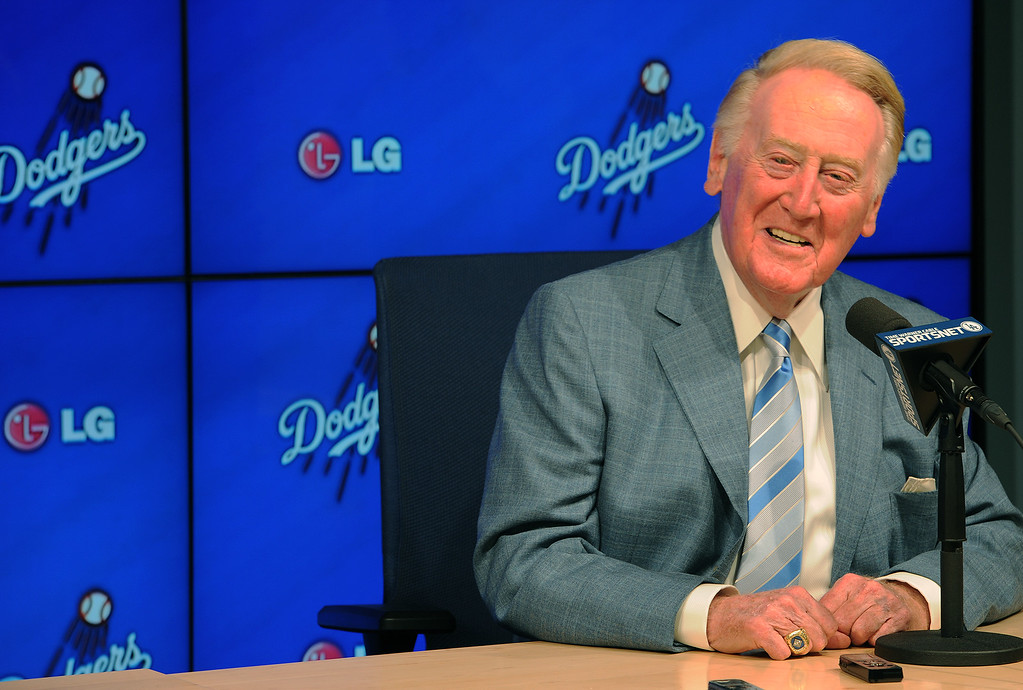 . File - Hall of Fame broadcaster Vin Scully, an icon in American sports history, will return to the Dodger broadcast booth for an unprecedented 66th season in 2015. The announcement was made by several Dodger players on Dodger Vision during last night�s game against the Atlanta Braves. Los Angeles, CA. 7/30/2014 (Photo by John McCoy Daily News)
