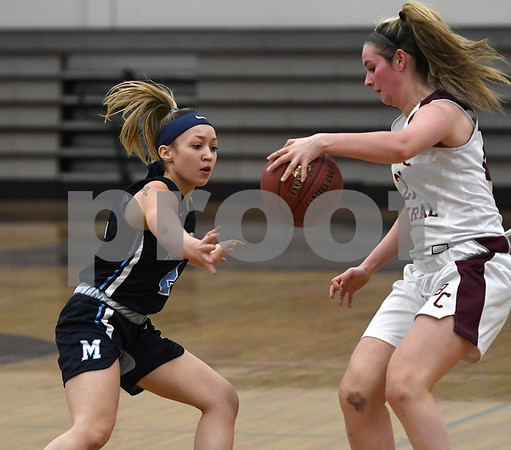 12/19/2017 Mike Orazzi | Staff Bristol Central's Sarah Guerin (22) and Middletown's Amanda Fudge (2) during Tuesday night's girls basketball game at BC.