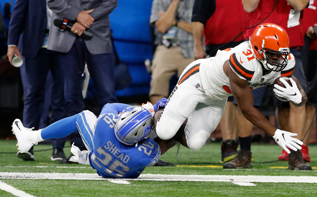 . Detroit Lions defensive back DeShawn Shead (26) stops Cleveland Browns running back Nick Chubb (31) during the first half of an NFL football preseason game, Thursday, Aug. 30, 2018, in Detroit. (AP Photo/Carlos Osorio)