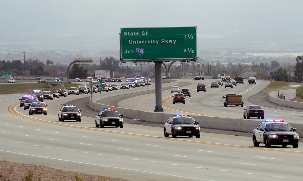 . BN22-MACKAY-FUNERAL-04-JCM (Jennifer Cappuccio Maher/Staff Photographer) The funeral procession for San Bernardino County Sheriff\'s Detective Jeremiah MacKay heads westbound on the 210 freeway Thursday, February 21, 2013, in Rialto.
