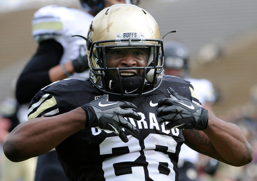 . BOULDER, CO.- APRIL13: Tony Jones celebrates his touchdown in the end zone. The University of Colorado football team hosts its spring football game at Folsom Field under the direction of new head coach Mike MacIntyre. (Photo By Kathryn Scott Osler/The Denver Post)