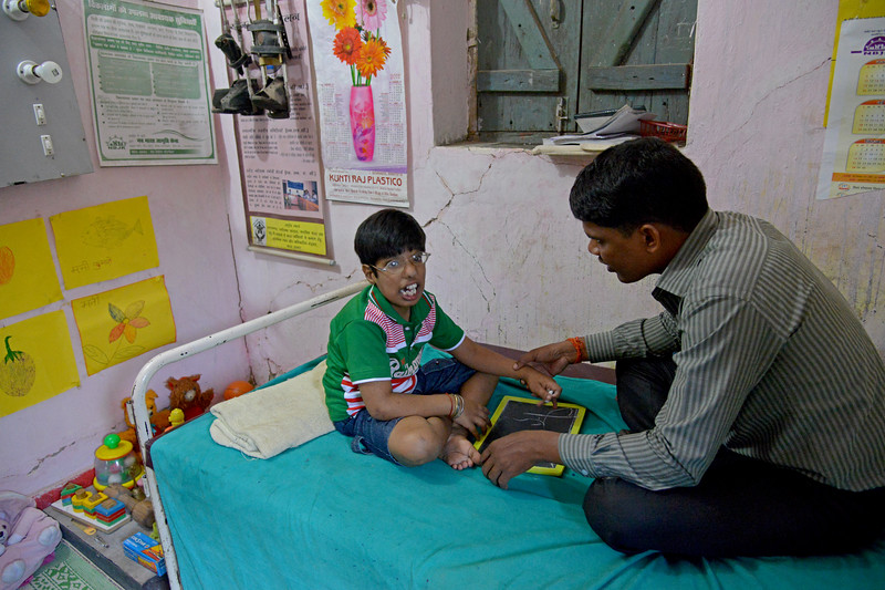 Children who have both visual and auditory disability come to Nav Bharat Jagriti Kendra (NBJK) to learn everyday activity skills, mobility, reading, colouring and writing.<br />  <br /> Nav Bharat Jagriti Kendra (NBJK) was established in 1971 by four engineering graduates who <br /> were sensitive to the causes of disparity, exploitation and poverty with an aim to <br /> establish a just society. Today they are the leading non-profit organization in Jharkhand <br /> running educational institution and health facilities.