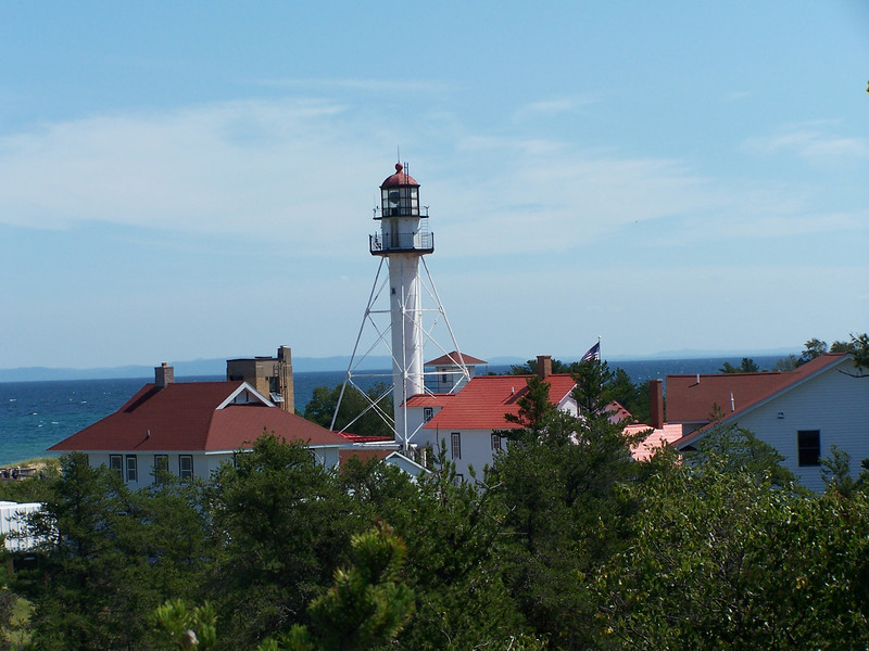 """Whitefish Point Light Station:  President Abraham Lincoln, concerned about mariners' safety and protecting the Union's supply of iron ore, ordered a more resilient sentinel be built. An """"iron pile"""" lighthouse providing the necessary structure to withstand the elements was constructed in 1861."""