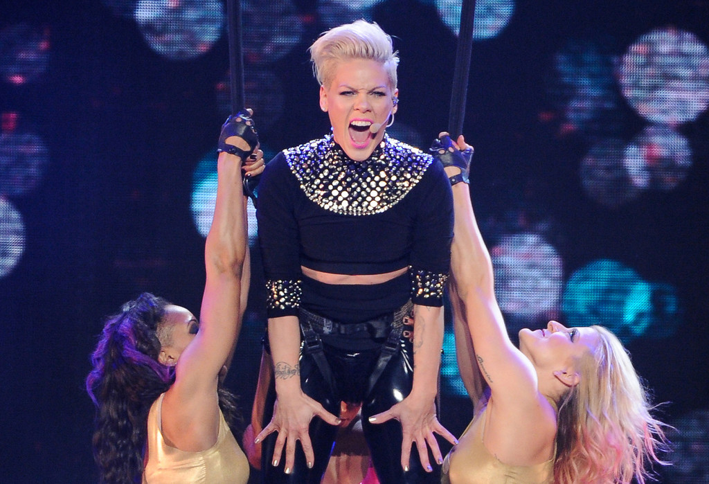 """. FILE - This March 22, 2013 file photo shows singer Pink during her \""""The Truth About Love\"""" tour at Madison Square Garden in New York. Pink\'s \""""Just Give Me a Reason (feat. Nate Ruess),\"""" is the top song on  iTunes\' Official Music Charts for the week ending April 15, 2013. (Photo by Evan Agostini/Invision/AP, file)"""