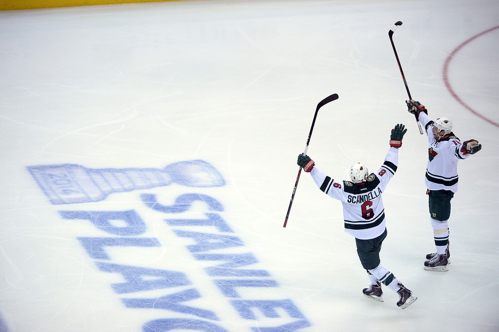 . DENVER, CO - APRIL 26: Dany Heatley (15) of the Minnesota Wild and Marco Scandella (6) celebrate a game-tying 3-2 goal by teammate Kyle Brodziak (21) against the Colorado Avalanche during the third period. The Colorado Avalanche hosted the Minnesota Wild during game five of the first round of the NHL Stanley Cup Playoffs at the Pepsi Center on Saturday, April 26, 2014. (Photo by Karl Gehring/The Denver Post)