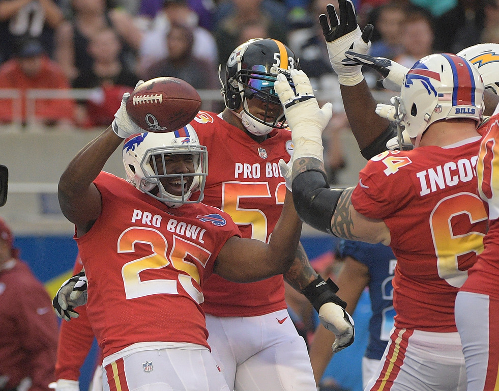 . AFC running back LeSean McCoy (25) of the Buffalo Bills, celebrates a touchdown with center Maurkice Pouncey (53), of the Pittsburg Steelers and guard Richie Incognito (64), of the Buffalo Bills, during the second half of the NFL Pro Bowl football game, Sunday, Jan. 28, 2018, in Orlando, Fla. (AP Photo/Phelan M Ebenhack)