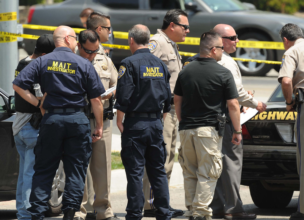 . California Highway Patrol officers and authorities at the scene of an officer-involved shooting on Thursday afternoon in San Bernardino following a car chase on the 10 Freeway. (LaFonzo Carter / Staff Photographer)
