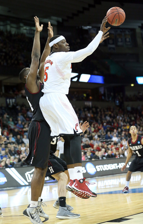 . Justin Jackson #5 of the Cincinnati Bearcats passes the ball during their game against the Harvard Crimson in the second round of the 2014 NCAA Men\'s Basketball Tournament at Spokane Veterans Memorial Arena on March 20, 2014 in Spokane, Washington.  (Photo by Stephen Dunn/Getty Images)