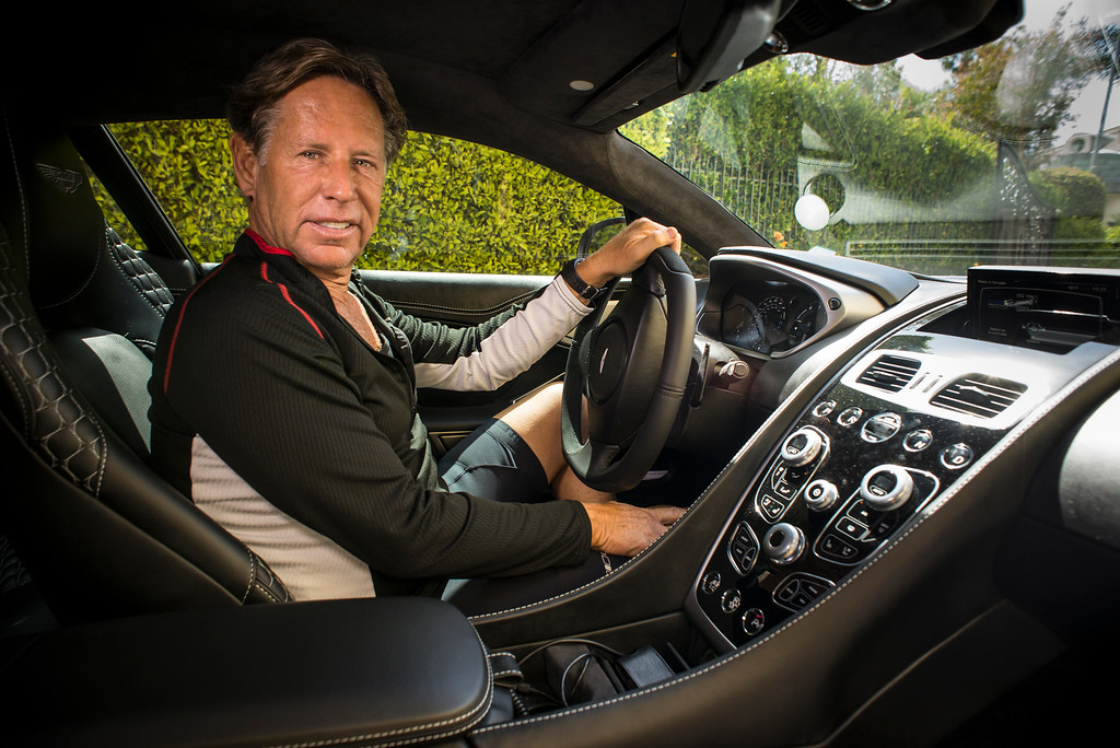 . Mark Maron\'s  in the drivers seat of his new 2014 Aston Martin Vanquish.  The V-12, 600hp carbon fiber supercar starts around $300,000.00.  Photo by David Crane/Los Angeles Daily News