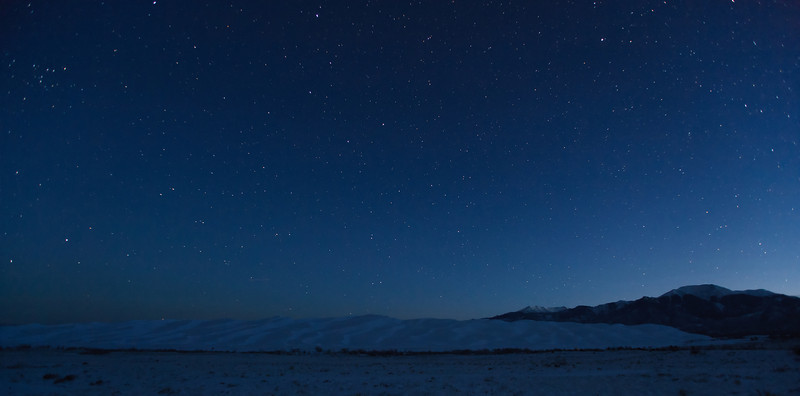 Starry night above the snow covered Great Sand Dunes National Park and Preserve.