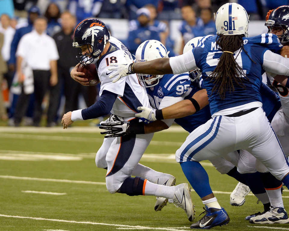 . INDIANAPOLIS, IN - OCTOBER 20: Denver Broncos quarterback Peyton Manning (18) gets sacked by Indianapolis Colts defensive end Fili Moala (95) during the fourth quarter October 20, 2013 at Lucas Oil Field. Photo by John Leyba/The Denver Post)