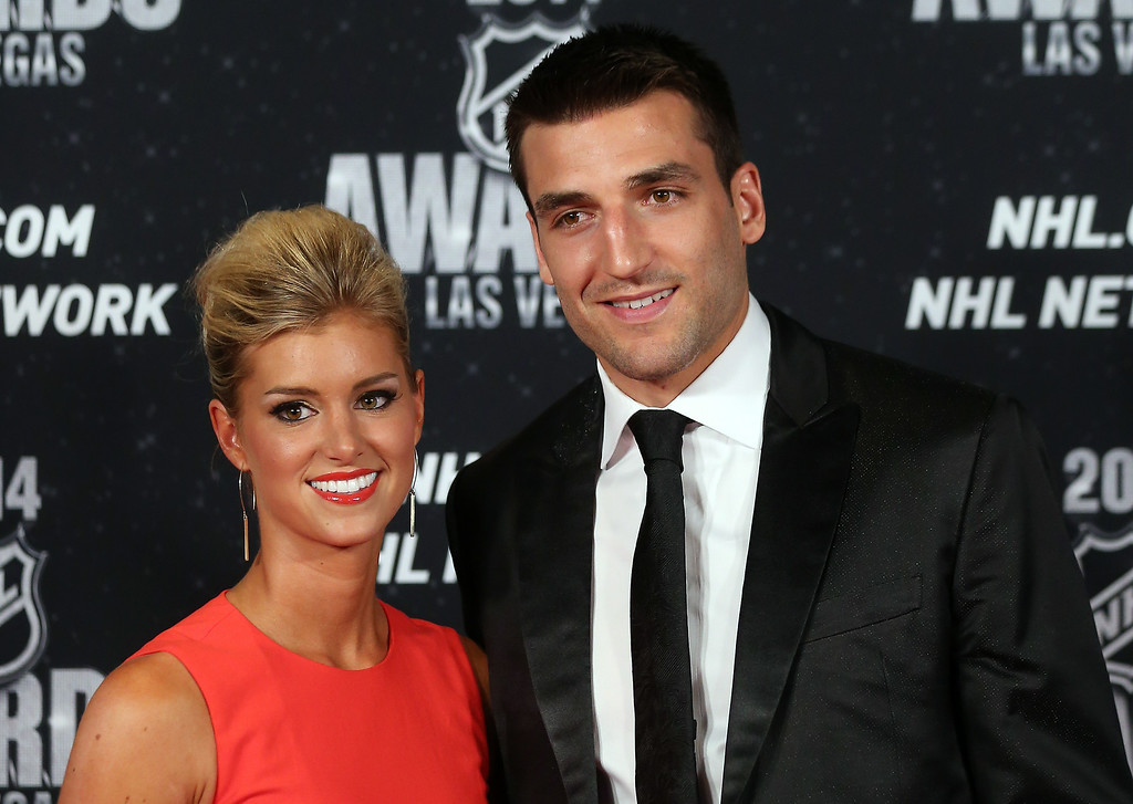 . Patrice Bergeron of the Boston Bruins and his wife Stefanie Bertrand arrive on the red carpet prior to the 2014 NHL Awards at Encore Las Vegas on June 24, 2014 in Las Vegas, Nevada.  (Photo by Bruce Bennett/Getty Images)