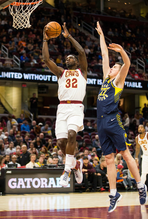 . Cleveland Cavaliers\' John Holland (32) makes a layup past Indiana Pacers\' T.J. Leaf (22) during the second quarter of an NBA preseason basketball game, Friday, Oct. 6, 2017, in Cleveland. (AP Photo/Scott R. Galvin)