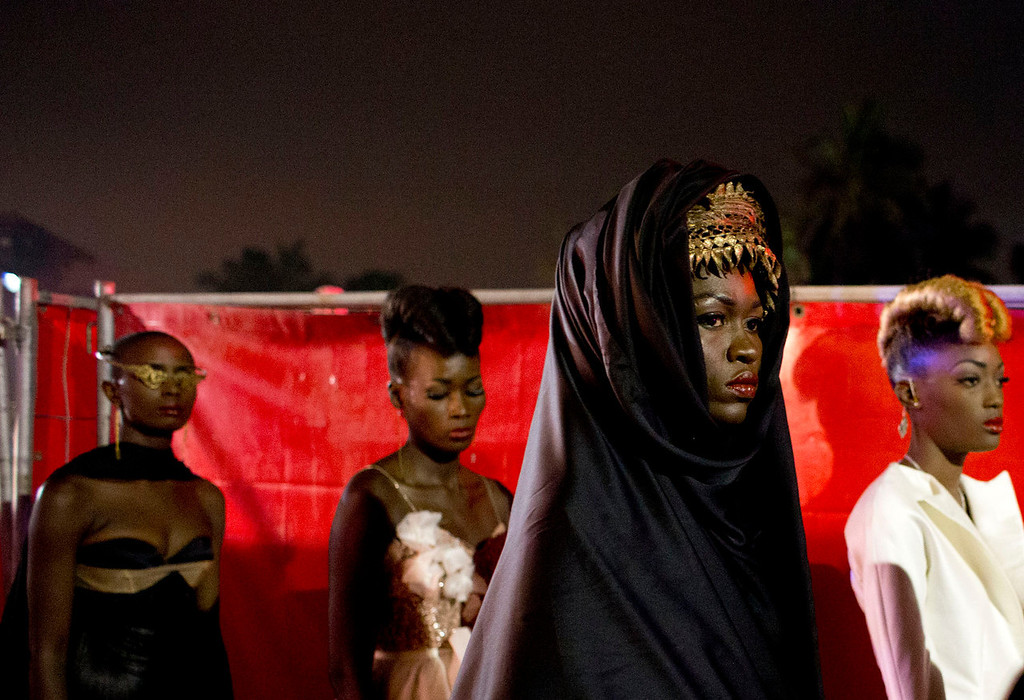 . Models wear designs by Elie Kuame of Lebanon and Ivory Coast as they wait to walk the runway at Hotel des Almadies, in Dakar, Senegal, Saturday, June 22, 2013. After a Friday show held in a dusty marketplace in the working class suburb of Guediawaye, the runway finale of Dakar Fashion Week was held at a luxury hotel and showcased the work of 14 designers from West Africa, Europe, South America, and the Caribbean. (AP Photo/Rebecca Blackwell)