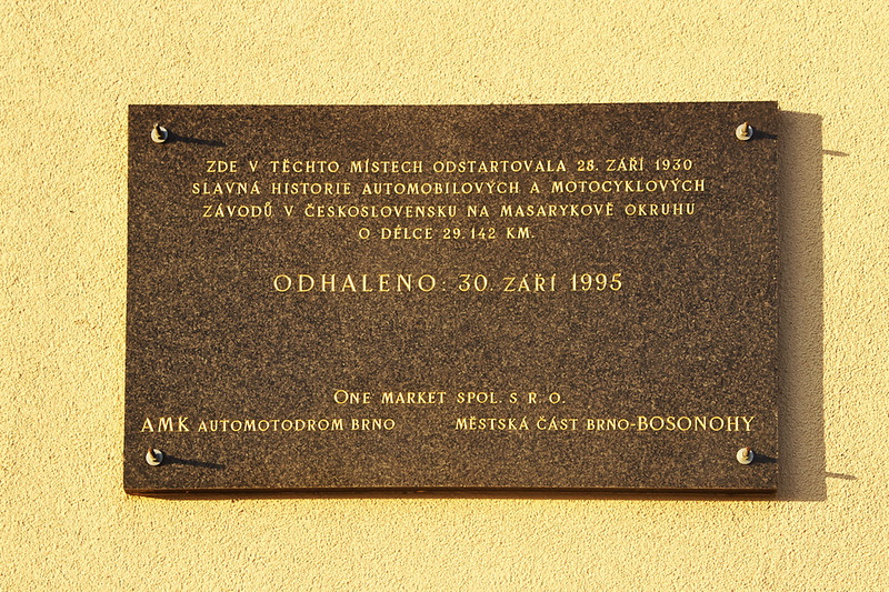 "The plaque says: ""On 28th September 1930, the celebrated history of automobile and motorbike racing in Czechoslovakia has begun on this very spot here at the Masaryk Circuit, length 29.142 km. Unveiled: 30th September 1995."""