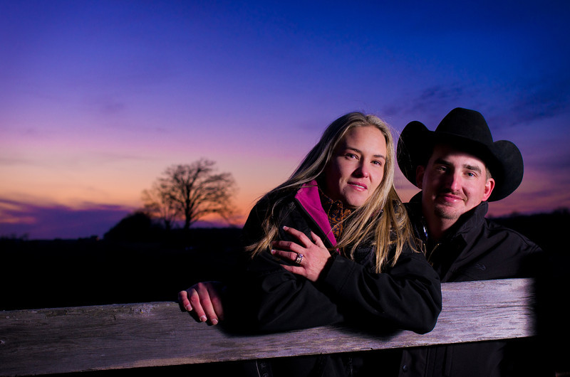 Couple at dusk during winter engagement photos at a family ranch near Severson Dells in Rockford, IL
