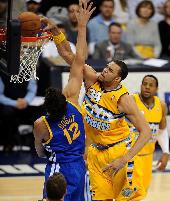 . DENVER, CO. - APRIL 20: Denver Nuggets center JaVale McGee (34) dunks the ball in the second quarter. The Denver Nuggets took on the Golden State Warriors in Game 1 of the Western Conference First Round Series at the Pepsi Center in Denver, Colo. on April 20, 2013. (Photo by Steve Nehf/The Denver Post)
