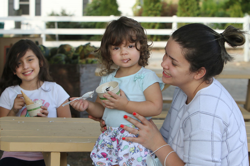 Features at Hollis Hills Farm in Fitchburg. Bruna Ferreira of Lunenburg and daughters Ana, 9, and Alissa, 1, stop for ice cream. (Sentinel & Enterprise/Julia Malakie)