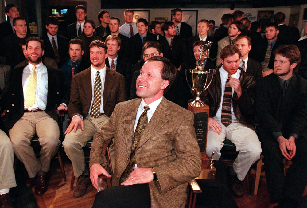 . DU Ice hockey team head coach George Gwozdecky, center, and players are watching NCAA Tournament selection show to find  out its fate at Jackson\'s Hole of Marriott Hotel on Sunday  morning. DU will play against Michigan on Friday.  HYOUNG CHANG/THE DENVER POST