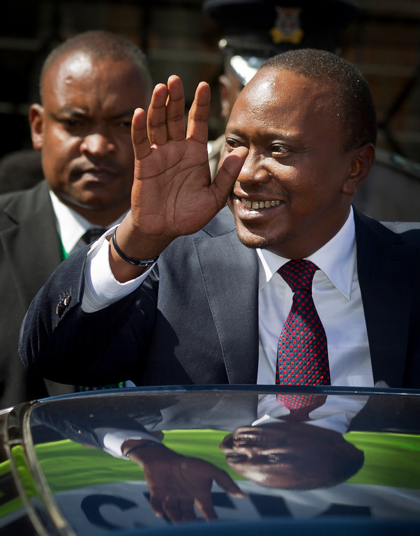 . Kenya\'s President-Elect Uhuru Kenyatta gestures to supporters as he leaves the National Election Center where final election results were announced declaring he would be the country\'s next president, in Nairobi, Kenya, Saturday, March 9, 2013. (AP Photo/Ben Curtis)