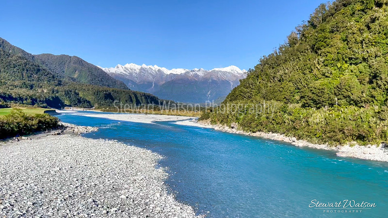 The blue waters in  the Whataroa river