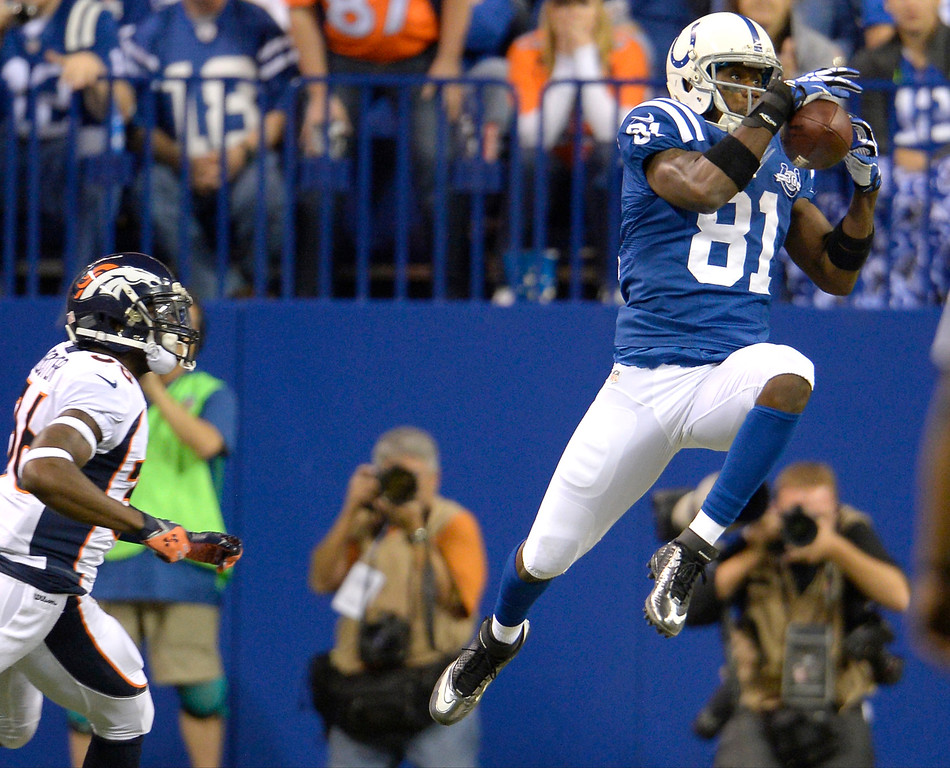 . INDIANAPOLIS, IN. - October 20: wide receiver Darrius Heyward-Bey (81) of the Indianapolis Colts makes a catch in the first half against the Denver Broncos at Lucas Oil Stadium. October 20, 2013 Indianapolis, Indiana. (Photo By Joe Amon/The Denver Post)