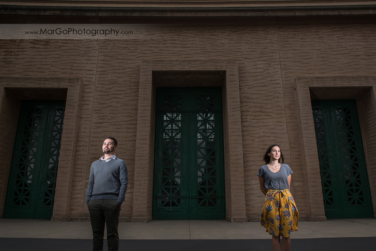 engagement session at Palace of Fine Arts in San Francisco - couple in front of green door